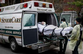 FILE - a patient is loaded into an ambulance by emergency medical workers outside Cobble Hill Health Center in the Brooklyn borough of New York.
