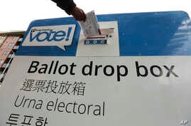 Voters drop off ballots in the Washington State primary, March 10, 2020 in Seattle.