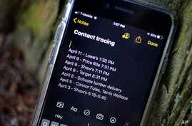 A smartphone belonging to Drew Grande, 40, of Cranston, R.I., shows notes he made for contact tracing, April 15, 2020.
