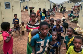 Children of around 6,000 ethnic Fulanis who have been displaced by attacks, gather in a makeshift camp for the displaced in Youba in Yatenga province in Burkina Faso, April 20, 2020.