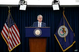 FILE - In this March 3, 2020 file photo, Federal Reserve Chair Jerome Powell speaks during a news conference to discuss an…