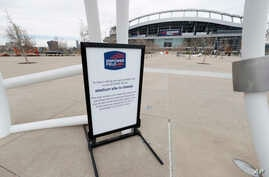 A grounds closed sign stands outside Empower Field at Mile High, the home of the NFL Denver Broncos, Thursday, April 30, 2020,…