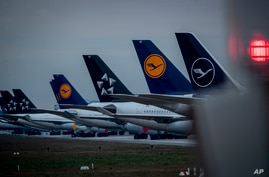 Aircrafts of German Lufthansa airline are parked on a runway at the airport in Frankfurt, Germany, Monday, May 4, 2020…