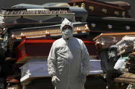 An employee of Xochimilco's crematorium waits for a corpse, suspected to have died of the new coronavirus, in Mexico City,…