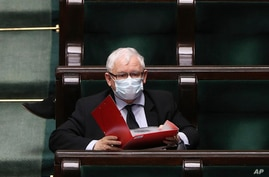 Poland's main ruling party leader Jaroslaw Kaczynski, wears a mask for protection against coronavirus in parliament during work on new legislation in Warsaw, Poland, Tuesday, May 12, 2020.