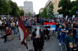 People attend a protest after arrest of the Serbian Orthodox Church priests in Montenegro, in Belgrade, Serbia, Thursday, May 14, 2020.
