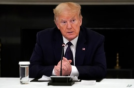 President Donald Trump listens during a meeting with restaurant industry executives about the coronavirus response