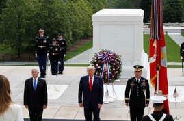 President Donald Trump stands with Vice President Mike Pence and Gen Omar Jones, Commanding General at Joint Force Headquarters…