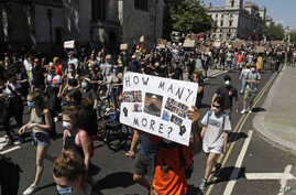 People march towards Trafalgar Square in central London on May 31, 2020