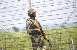 FILE - An Indian soldier patrols along the India-Pakistan border in Akhnoor near Jammu, Aug. 14, 2019.