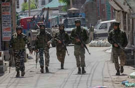 Indian paramilitary soldiers are seen after gun battle with suspected rebels ended in Srinagar, Indian controlled Kashmir, May 19, 2020.