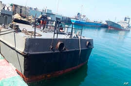 In this photo provided Monday, May 11, 2020, by the Iranian Army, the Konarak support vessel which was struck during a training exercise in the Gulf of Oman, is docked in an unidentified naval base in Iran.