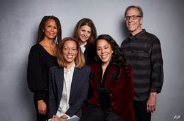 "FILE - Sil Lai Abrams, back row from left, director Amy Ziering, director Kirby Dick, Drew Dixon, seated left, and Sheri Hines pose for a portrait to promote the film ""On the Record"" at the Music Lodge during the Sundance Film Festival in Park City, Utah."