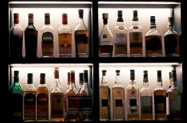 FILE - A vast array of fine single malt Scotch bottles are seen in a display case at a bar, in Boston, Massachusetts, Dec. 10, 2019.