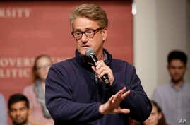 "FILE - MSNBC television anchor Joe Scarborough, co-host of the show ""Morning Joe,"" takes questions at a Harvard University student forum, in Cambridge, Massachusetts, Oct. 11, 2017."