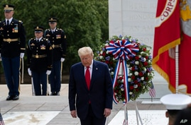 President Donald Trump turns after placing a wreath at the Tomb of the Unknown Soldier, at Arlington National Cemetery, in honor of Memorial Day, in Arlington, Virginia, May 25, 2020.