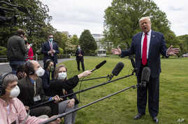 President Donald Trump speaks with reporters on the South Lawn of the White House, in Washington, May 14, 2020.