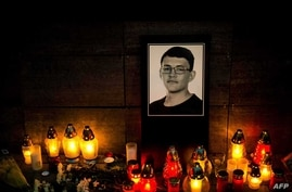 Candles and a portrait of Slovak investigative journalist Jan Kuciak