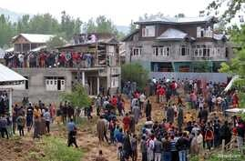 People gather after several militants, including Hizbul Mujahideen commander Riyaz Naikoo were killed in a gun battle with Indian soldiers, at Beighpora village in south Kashmir's Pulwama district, May 6, 2020.