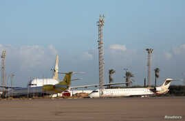 FILE - Planes are seen at Mitiga Airport in Tripoli, Libya, Dec. 12, 2019.