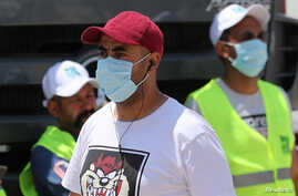 Men wearing protective face masks are seen in downtown Cairo, Egypt, amid concerns about the spread of the coronavirus disease (COVID-19), May 2, 2020.