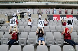 Mannequins are placed in spectator seats to cheer South Korea's football club FC Seoul team during a match against Gwangju FC, which is held without fans due to the coronavirus disease (COVID-19) outbreak, in Seoul, May 17, 2020.
