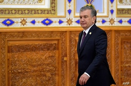 Uzbek President Shavkat Mirziyoyev walks to attend the Conference on Interaction and Confidence-Building Measures in Asia (CICA…
