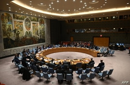 German Foreign Minister Heiko Maas (C) speaks at a UN Security Council meeting at United Nations headquarters in New York on…
