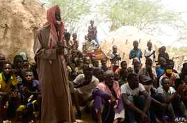 Residents of Zibane-Koira Zéno, a village in the Tillabéri region (western Niger close to Mali) attend a meeting on May 12, 2020, after an attack by armed men on May 8, 2020.
