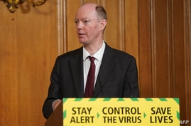 A handout image released by 10 Downing Street, shows Britain's Chief Medical Officer for England Chris Whitty attending a…
