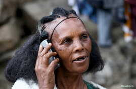 A woman makes a call on her mobile phone in Ethiopia's capital, Addis Ababa, November 9, 2015.