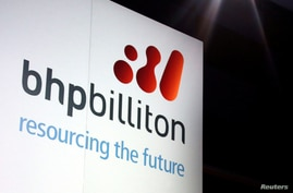 FILE - A promotional sign adorns a stage at a BHP Billiton function in central Sydney, Australia August 20, 2013.