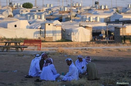 Displaced Iraqi men from the minority Yazidi sect, who fled the Iraqi town of Sinjar, are seen at the Khanki camp on the…