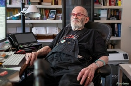 FILE PHOTO: AIDS activist and author Larry Kramer poses for a portrait in his apartment in New York, U.S., June 24, 2019…