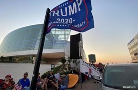 Supporters of U.S. President Donald Trump camp outside the BOK Center, the venue for his upcoming rally, in Tulsa, Oklahoma
