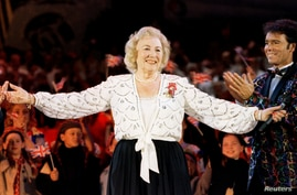 FILE PHOTO: Dame Vera Lynn receives the applause from the audience and fellow performer Cliff Richard during a concert in Hyde…
