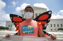 DACA recipient Luis Zuluaga, who immigrated to the United States from Colombia when he was 3-years-old, celebrates