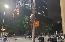 A Confederate statue is seen hanging on a street post in Raleigh, North Carolina, U.S. June 19, 2020 in this picture obtained from social media.
