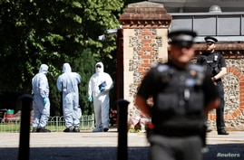 Police officers and forensic officers are pictured near the scene of reported multiple stabbings in Reading, Britain, June 22,…