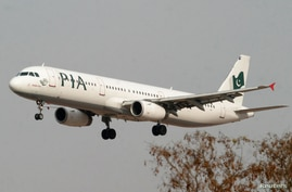 FILE PHOTO: A Pakistan International Airlines (PIA) plane prepares to land at Islamabad airport in Islamabad February 24, 2007…