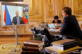 French President Emmanuel Macron talks with Russian President Vladimir Putin during a video conference at the Elysee Palace in Paris, France, June 26, 2020.