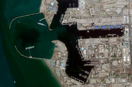 In this June 8, 2020 satellite photo provided by Maxar Technologies, a fake aircraft carrier is seen