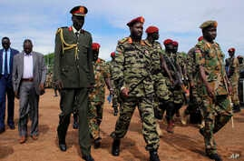 South Sudan's President Salva Kiir, center, and newly appointed army chief of staff Lt. Gen. James Ajongo Mawut,