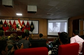 Journalists watch a confessional video of a Lashkar-e-Taiba militant during a press conference by the Indian army and the…