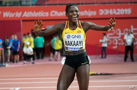 Halimah Nakaayi, of Uganda celebrates as she wins the gold medal in the women's 800 meter final at the World Athletics…