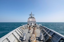 In this Tuesday, Nov. 12, 2019, photo, made available by U.S. Navy, the Ticonderoga-class guided-missile cruiser USS…