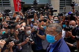 Hong Kong media tycoon Jimmy Lai, center, arrives at court for charges relating to unlawful protests from last year in Hong…