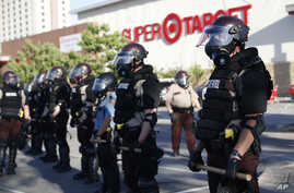 Minnesota State Police protect a Target Store, May 28, 2020, in St. Paul, Minn.