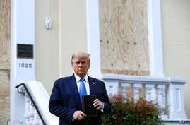 President Donald Trump holds a Bible as he visits outside St. John's Church across Lafayette Park from the White House