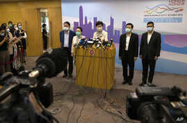 Hong Kong Chief Executive Carrie Lam speaks during a press conference after meeting Chinese leadership in Beijing, June 3, 2020. British PM Boris Johnson said the United Kingdom stands ready to open the door to almost 3 million Hong Kong citizens.